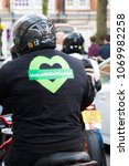 London, United Kingdom, 14th April 2018:- Bikers leading a silent march from Kensington Town Hall to the ruins of Grenfell tower ten months on from the devastating fire that killed 71 - stock photo