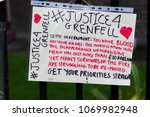 London, United Kingdom, 14th April 2018:- Banners near the ruins of Grenfell tower ten months on from the devastating fire that killed 71 in Kensington and Chelsea - stock photo