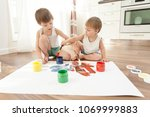 two brothers draw paints ... | Shutterstock . vector #1069999883