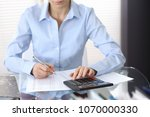 female bookkeeper or financial... | Shutterstock . vector #1070000330