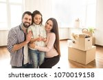 a picture of father  mother and ... | Shutterstock . vector #1070019158