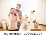 happy couple are standing... | Shutterstock . vector #1070021129