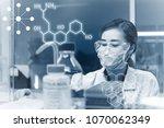 asian scientist working in the... | Shutterstock . vector #1070062349