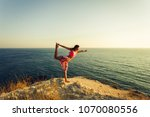 young woman doing yoga on a... | Shutterstock . vector #1070080556