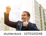 happy owner of a new house. man ... | Shutterstock . vector #1070103248