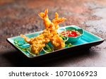 shrimps tempura with spicy... | Shutterstock . vector #1070106923