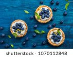 delicious blueberry tartlets... | Shutterstock . vector #1070112848