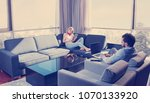young couple relaxing at home...   Shutterstock . vector #1070133920