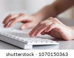 woman hands typing  | Shutterstock . vector #1070150363