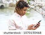 man texting on his cell phone... | Shutterstock . vector #1070150468