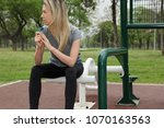 athlete woman using asthma... | Shutterstock . vector #1070163563