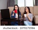 two smiling beautiful women... | Shutterstock . vector #1070173586