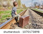little boy with suit case on... | Shutterstock . vector #1070173898