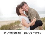 cheerful middle age couple in... | Shutterstock . vector #1070174969