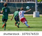 soccer player using head to hit ... | Shutterstock . vector #1070176523