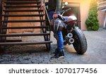 motorcyclist with helmet in... | Shutterstock . vector #1070177456
