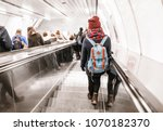 people stand on the escalator... | Shutterstock . vector #1070182370