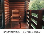 wooden chair on porch of cabin... | Shutterstock . vector #1070184569