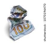 crumpled hundred dollar bill... | Shutterstock . vector #1070196470