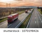 caravan or convoy of red lorry... | Shutterstock . vector #1070198426