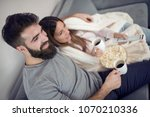 happy young couple sitting on... | Shutterstock . vector #1070210336