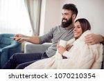 happy couple watching...   Shutterstock . vector #1070210354