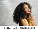 portrait of happy latina woman... | Shutterstock . vector #1070240438