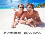 portrait of happy young couple... | Shutterstock . vector #1070246900