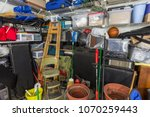 messy residential garage packed ... | Shutterstock . vector #1070259443
