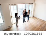 family buying new house | Shutterstock . vector #1070261993