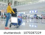 pretty asian woman with luggage ... | Shutterstock . vector #1070287229