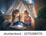two cute little children are... | Shutterstock . vector #1070288570