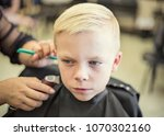 a cute young blonde boy getting ... | Shutterstock . vector #1070302160