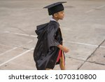 congratulated kid graduate in... | Shutterstock . vector #1070310800