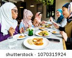islamic friends dining together | Shutterstock . vector #1070315924