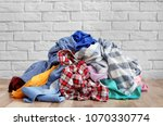 pile of dirty clothes on floor... | Shutterstock . vector #1070330774