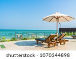 beautiful umbrella and chair... | Shutterstock . vector #1070344898