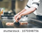 hand of man take cooking of... | Shutterstock . vector #1070348756
