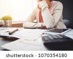 worried young asian woman... | Shutterstock . vector #1070354180