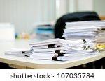 pile of document on desk | Shutterstock . vector #107035784