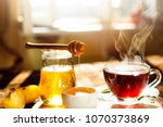 sweet tea with lemon and honey... | Shutterstock . vector #1070373869