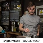 waiter making coffee at the... | Shutterstock . vector #1070376050