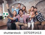 happy friends or football fans... | Shutterstock . vector #1070391413