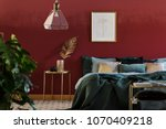 simple poster hanging above bed ... | Shutterstock . vector #1070409218