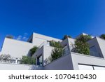 grey apartment building with... | Shutterstock . vector #1070410430