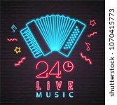 accordion icon live music neon... | Shutterstock .eps vector #1070415773
