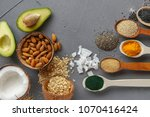 superfood in spoons over gray... | Shutterstock . vector #1070416424