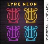 lyre instrument icon neon light ... | Shutterstock .eps vector #1070421248