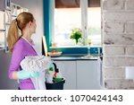 young woman in rubber gloves... | Shutterstock . vector #1070424143