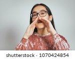beautiful asian woman is... | Shutterstock . vector #1070424854